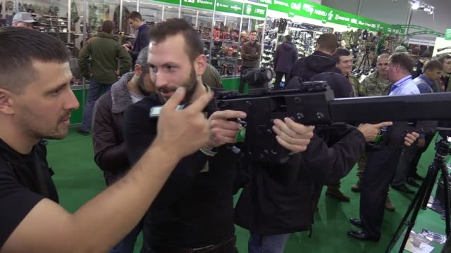 "visitors test guns during ""arms and security 2016"" exhibition in kiev, ukraine,11 october 2016. the xii international specialized exhibition ""arms... - security equipment stock videos & royalty-free footage"