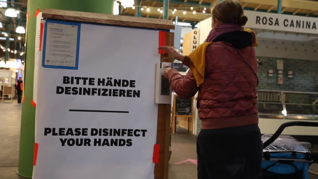 visitors to a market use hand disinfectant amidst the global spread of coronavirus on march 20 2020 in berlin germany everyday life in germany has... - hygiene stock-videos und b-roll-filmmaterial