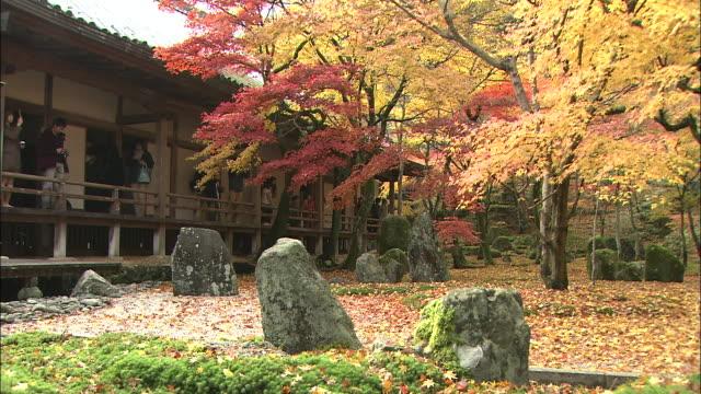Visitors to Komyo-zenji Temple photograph beautiful autumn leaves.