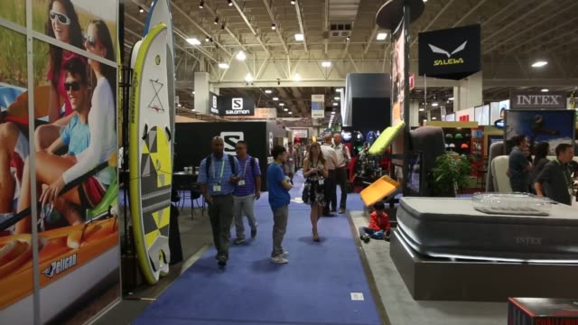 visitors to the outdoor retailers summer market show browse products on display in salt lake city on august 6 2015 shots a customer talks to a sales... - water sports equipment stock videos and b-roll footage