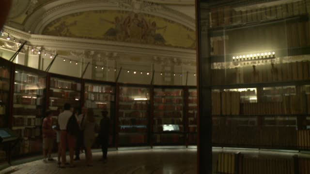visitors to thomas jefferson's library exhibit at the library of congress one is wearing a backpack - collection stock videos & royalty-free footage