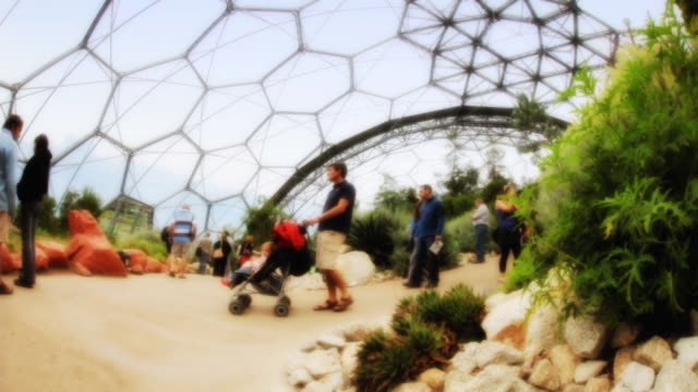 stockvideo's en b-roll-footage met t/l visitors tour the temperate house at the eden project / st. austell, england, united kingdom - breedbeeldformaat