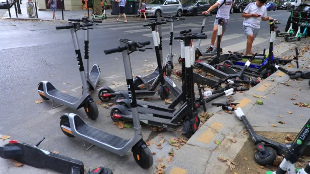 visitors try to rent electric scooters near the eiffel tower during the heat wave that hits the french capital on july 31 2020 in paris france... - large group of objects stock videos & royalty-free footage