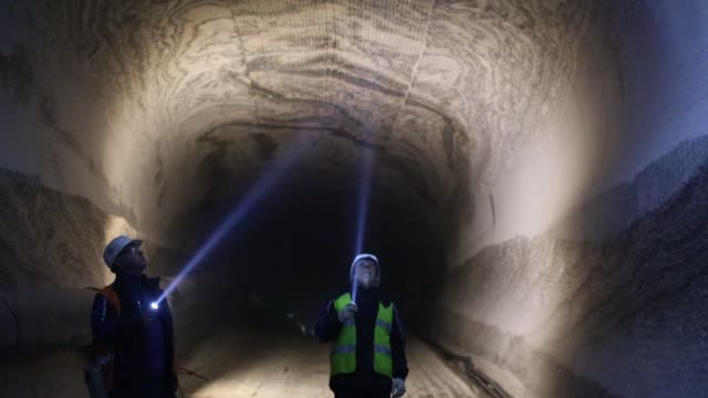 visitors use flashlights to inspect excavations for sylvinite mineral ore used to produce potash fertilizer in the underground potash mine at the... - electric torch stock videos & royalty-free footage