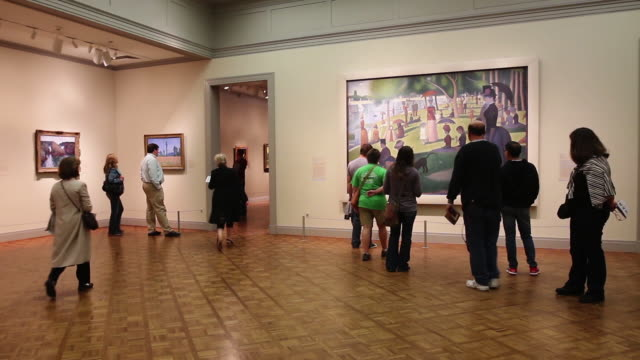 Visitors view the exhibits at the Art Institute of Chicago on September 17 2014 in Chicago Illinois The museum which draws around15 million visitors...