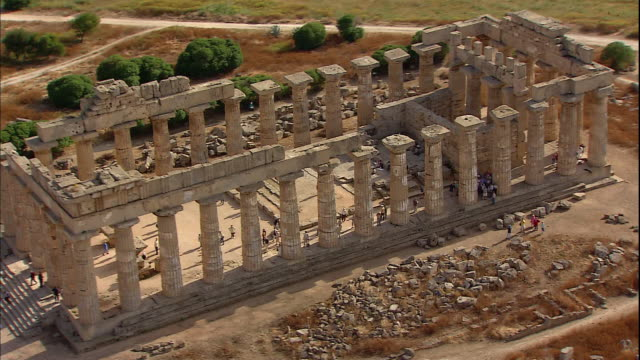 visitors view the ruins of a greek temple in the ancient city of selinunte, sicily. - sicily stock videos and b-roll footage