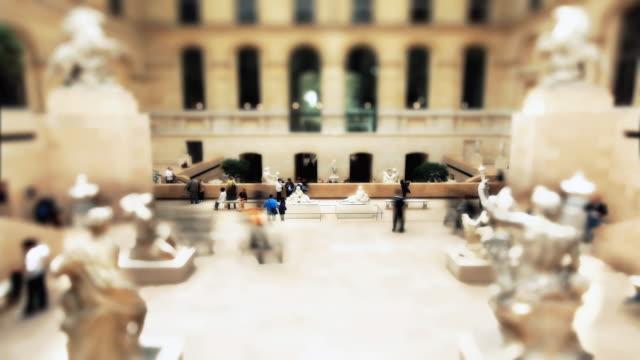T/L Visitors viewing the Cour Marly exhibit at the Louvre / Paris, Ile de France, France