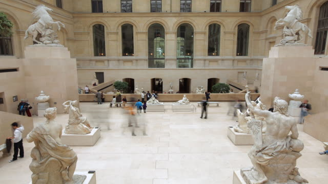 stockvideo's en b-roll-footage met t/l visitors viewing the cour marly works at the louvre / paris, ile de france, france - franse cultuur