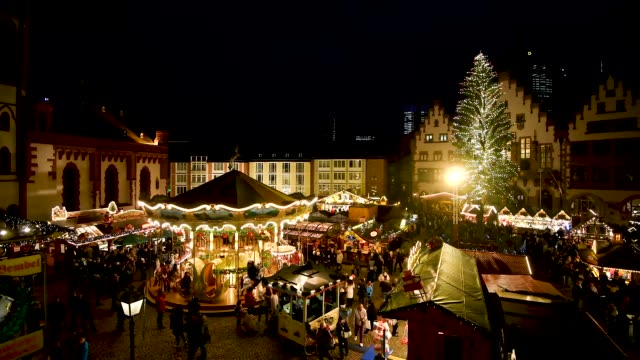 visitors walk among stalls selling mulled wine sausages christmas decorations and other delights at the annual christmas market at roemerberg on... - römerberg stock videos and b-roll footage