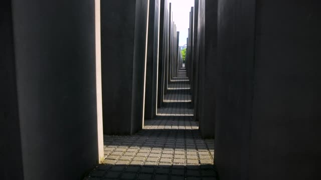 Visitors walk among stellar at the Memorial to the Murdered Jews of Europe also called the Holocaust Memorial on May 30 2018 in Berlin Germany The...