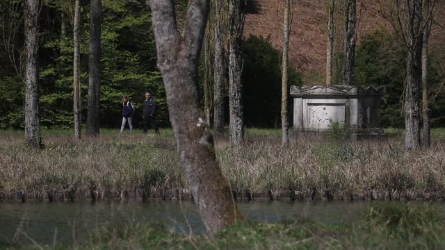 visitors walk by jean jacques rousseau's grave at the ile des peupliers in jean jacques rousseau park on april 22, 2021 in ermenonville, france. this... - daydreaming stock videos & royalty-free footage