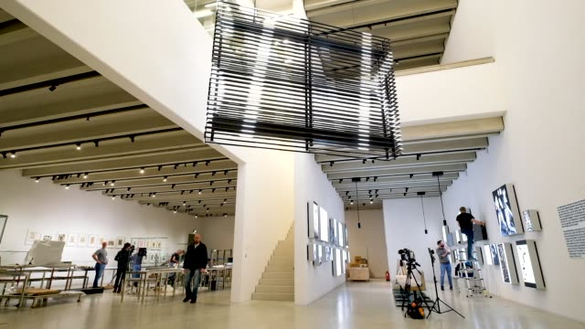 visitors walk in an exhibition space during a press preview at the new bauhausmuseum weimar on april 04 2019 in weimar germany the museum is devoted... - weimar video stock e b–roll
