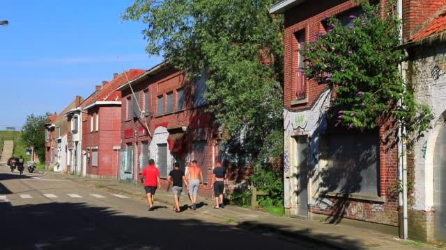 visitors walk in the ghost village of doel on july 13, 2020 in beveren, belgium. wedged between the second port in europe, antwerp that was supposed... - ghost town stock videos & royalty-free footage