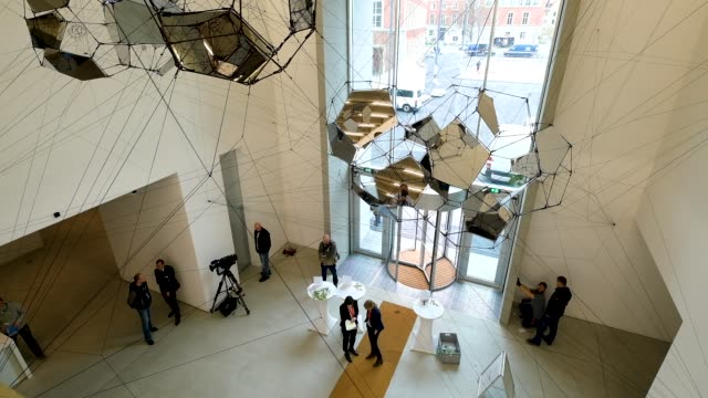 visitors walk in the main entrance hall at the new bauhausmuseum weimar on april 04 2019 in weimar germany the museum is devoted to the bauhaus and... - weimar video stock e b–roll