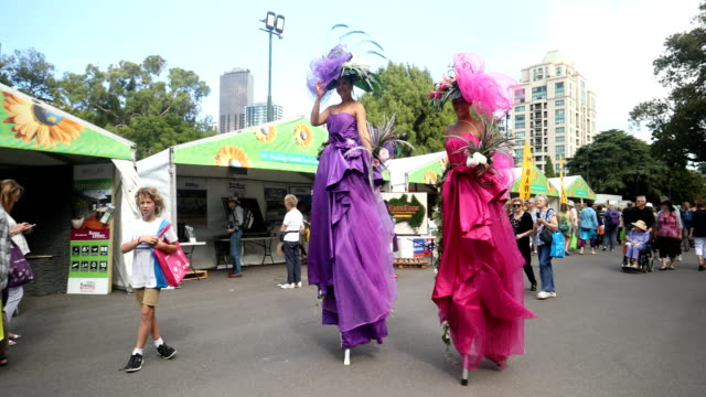 visitors walk on stilts at the melbourne international flower and garden show on march 29 2017 in melbourne australia - stilts stock videos and b-roll footage