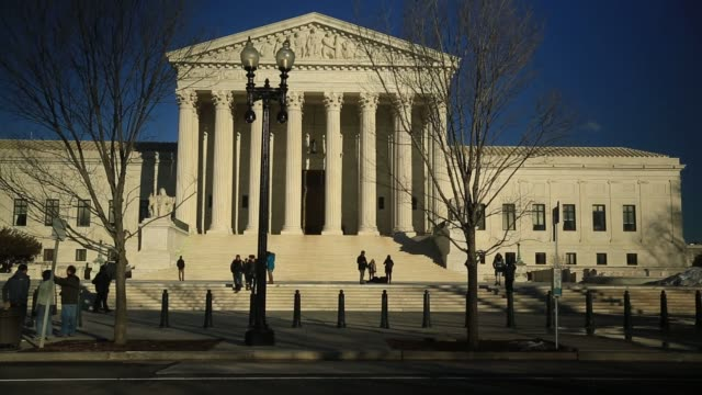 visitors walk on the steps of the us supreme court building in washington dc us on tuesday feb 16 2016 justice antonin scalia's unexpected death and... - us supreme court building stock videos and b-roll footage