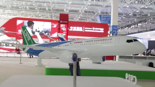visitors walk past a models of a commercial aircraft corp of china aircrafts on display at the china international aviation aerospace exhibition in... - tradeshow stock videos and b-roll footage