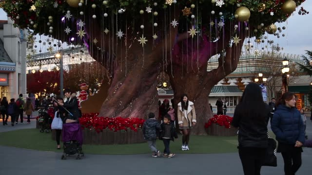 visitors walk past christmas decorations at the everland resort in yongin gyeonggi province south korea on friday nov 14 tilt up to top of... - festwagen stock-videos und b-roll-filmmaterial