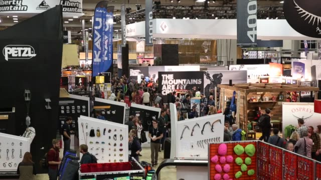 visitors walk through the 2016 outdoor retailers show at the salt place convention center in salt lake city, utah on thursday january 7, 2016.... - tradeshow stock videos & royalty-free footage