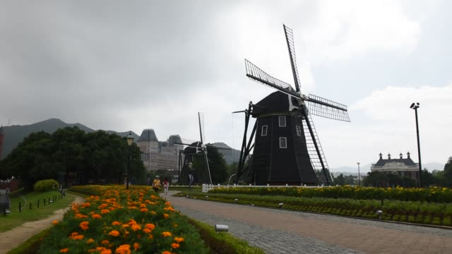 Visitors walk through the Dutchthemed Huis Ten Bosch amusement park operated by Huis Ten Bosch Co in Sasebo Nagasaki Prefecture Japan on Thursday...