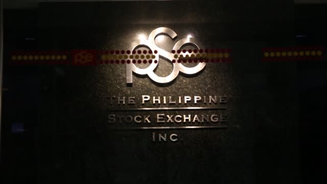 Visitors walk through the lobby of PSE Plaza which houses the Philippine Stock Exchange Inc headquarters in the Makati district of Manila the...