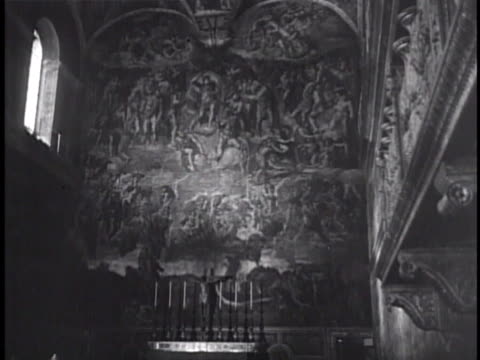 visitors walking along marble transenna in chapel 'the last judgment' fresco by michelangelo on alter wall male looking at ceiling w/ binoculars... - marble wall stock videos and b-roll footage