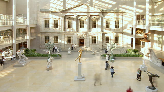 ha visitors walking around the metropolitan museum of art / new york city, new york, united states - museum stock videos & royalty-free footage