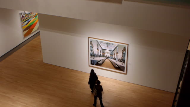 ws visitors walking in art museum exhibiting modern paintings / phoenix, arizona, usa - admiration stock videos & royalty-free footage