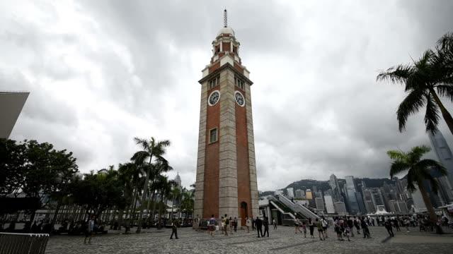 ws visitors walking in the hongkong clock tower - tsim sha tsui stock videos & royalty-free footage