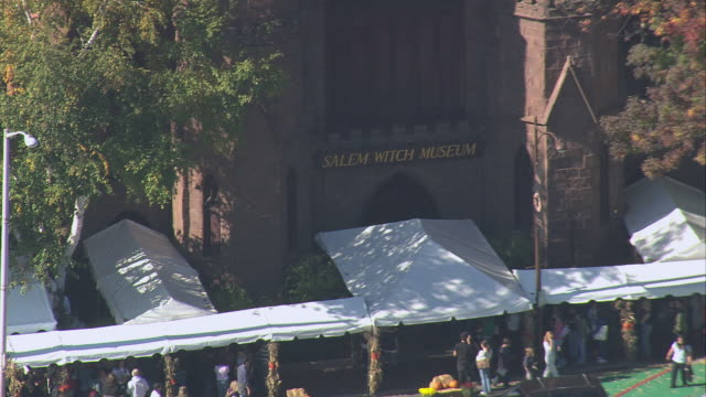 aerial visitors walking out front of the salem witch museum / massachusetts, united states - salem stock videos & royalty-free footage