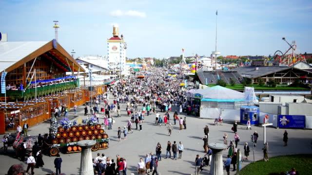 T/L Visitors Walking Through Oktoberfest Fairgrounds