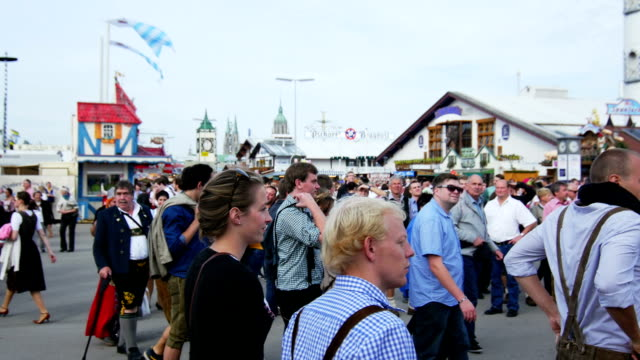 Visitors Walking Through Oktoberfest Fairgrounds (4K/UHD to HD)