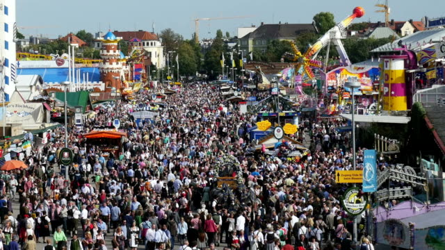 HA Visitors Walking Through Oktoberfest Fairgrounds (4K/UHD to HD)