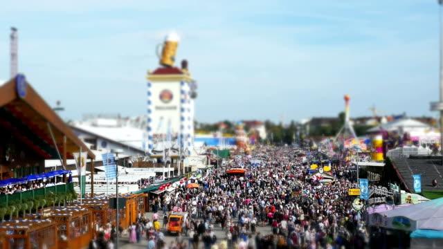 visitors walking walking through oktoberfest fairgrounds - fairground stall stock videos & royalty-free footage