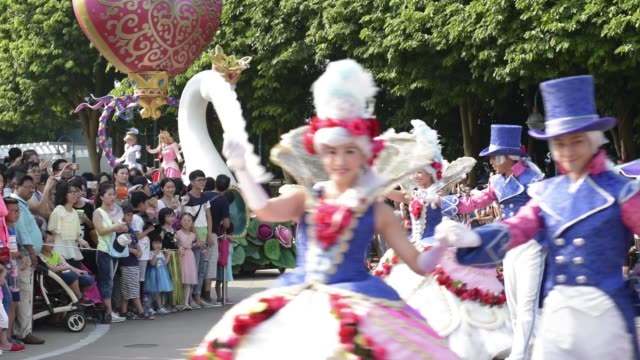 visitors watch a parade at walt disney co's disneyland resort in hong kong china on friday aug 7 actresses dressed as snow white cinderella and... - cinderella stock videos & royalty-free footage