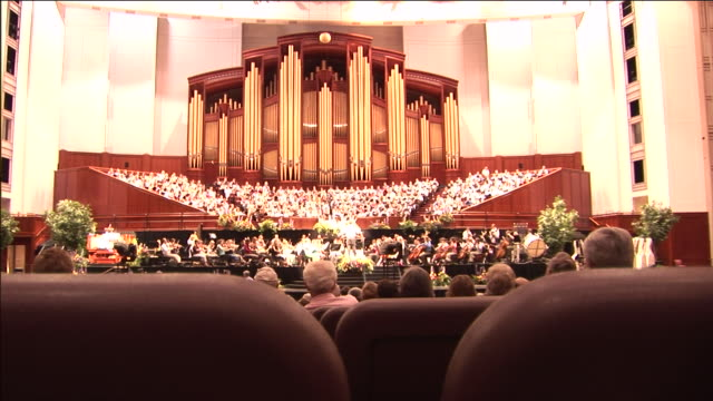 Visitors watch a performance of the Mormon Tabernacle Choir inside the Conference Center.