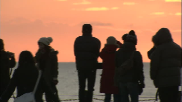 Visitors watch the First Sun of the Year rising over the Sea of Okhotsk in Japan.