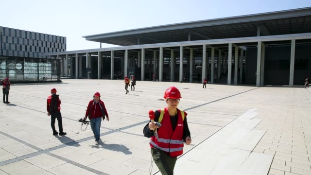 Visitors wear a construction safety helmet at the BER Willy Brandt Berlin Brandenburg International Airport on April 10 2018 in Schoenefeld Germany...