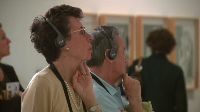 ms visitors wearing headphones at centro de arte renia sof?a modern art museum, madrid, spain - art museum stock videos & royalty-free footage