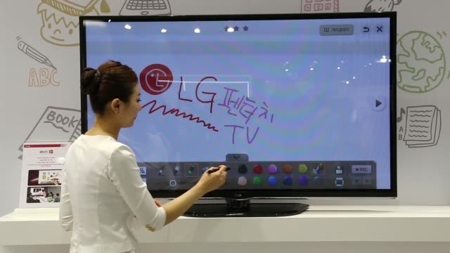 visitors wearing pairs of 3-d glasses watches lg electronics inc. curved 3-d screens at the world it show 2013 in seoul, visitors wearing 3-d glasses... - television game show stock videos & royalty-free footage