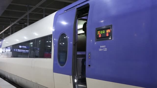 visitors with luggage disembark a korea train express sancheon highspeed train manufactured by hyundai rotem co onto a platform at gangneung station... - winter olympic games stock videos and b-roll footage