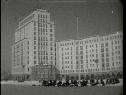 itn visits russian zone contrasts in old and new buildings in east berlin tx 19256 / 1030 pm east berlin ext / snow gv brandenburg gate with 'anfang... - anfang stock videos & royalty-free footage