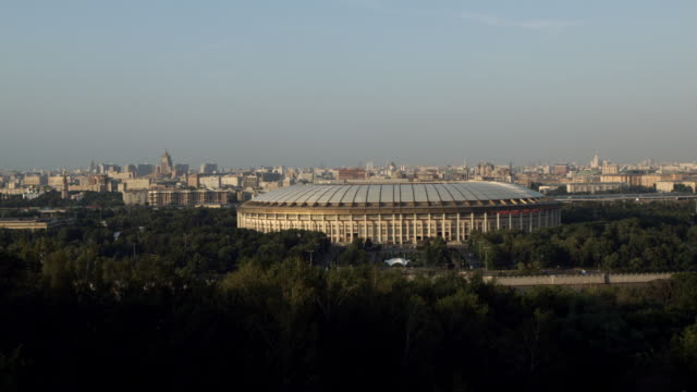 vista of Luzhniki Stadium with city skyline in background