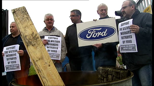 stockvideo's en b-roll-footage met visteon car parts firm / workers stage sit in; northern ireland: belfast: workers staging protest seen behind gates to factory, photographers taking... - plant stage