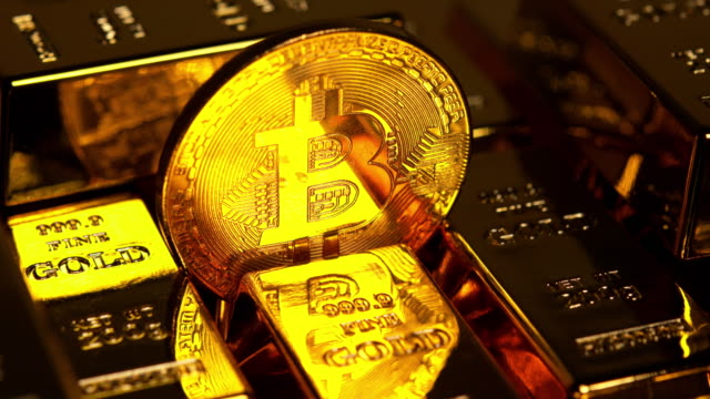 Visual bitcoin among gold bars Bitcoin is a worldwide digital currency that isn't controlled by a central authority such as a government or bank