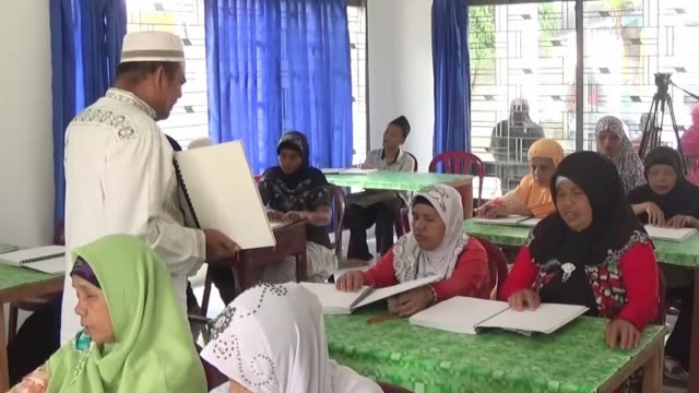 visually impaired indonesians read the braille copies of the muslims' holy book quran at disability rehabilitation center in medan during the holy... - holy book stock videos and b-roll footage