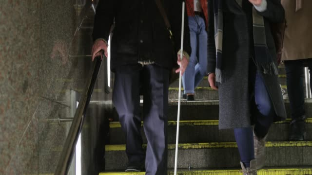 visually impaired man walking down steps - blindness stock videos & royalty-free footage