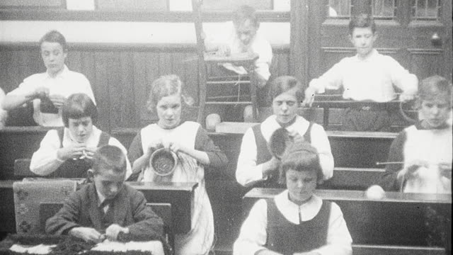 1925 montage visually impaired students in classroom weaving baskets, knitting and reading, and playing outdoor game maneuvering large ball at royal victoria school / newcastle upon tyne, england, united kingdom - blindness stock videos & royalty-free footage