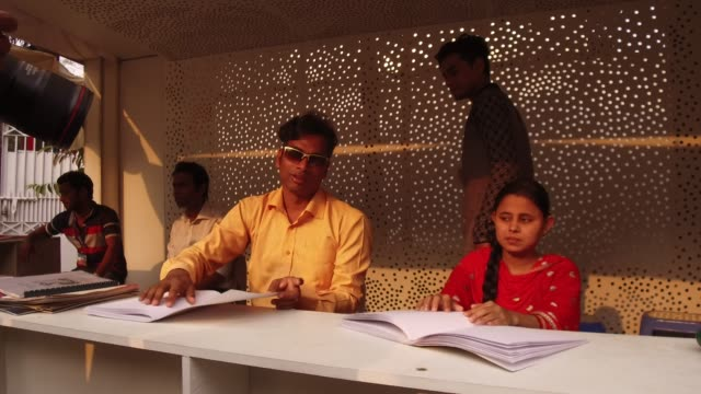 visually impaired youths going through braille version of books at book fair in dhaka, bangladesh, on february 10, 2018. according to the academy... - tecnologia assistiva video stock e b–roll