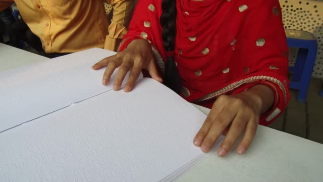 visually impaired youths going through braille version of books at book fair in dhaka bangladesh on february 10 2018 according to the academy... - blindness stock videos & royalty-free footage